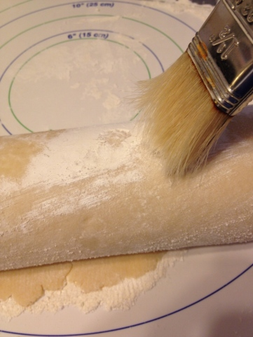 Brush off excess flour