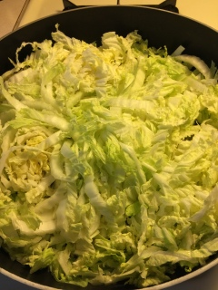 Cabbage is sauteed until wilted