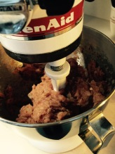 Mixing the meatball ingredients