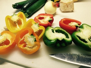 Halve the peppers so they stand flat