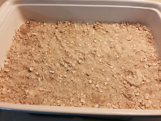 Half of streusel pressed in bottom